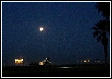 full moon over Huntington Beach