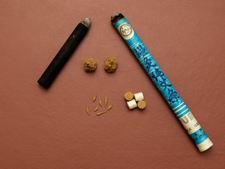 Moxibustion comes in several forms.  There are cigar-like sticks, smokeless moxa with a higher charcoal content, loose moxa which can be rolled into rice grains or bigger chunks, and even pre-rolled small cigars to be used on the handle of needles.